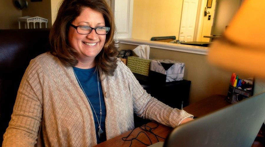 PA Virtual teacher smiling at class through her laptop