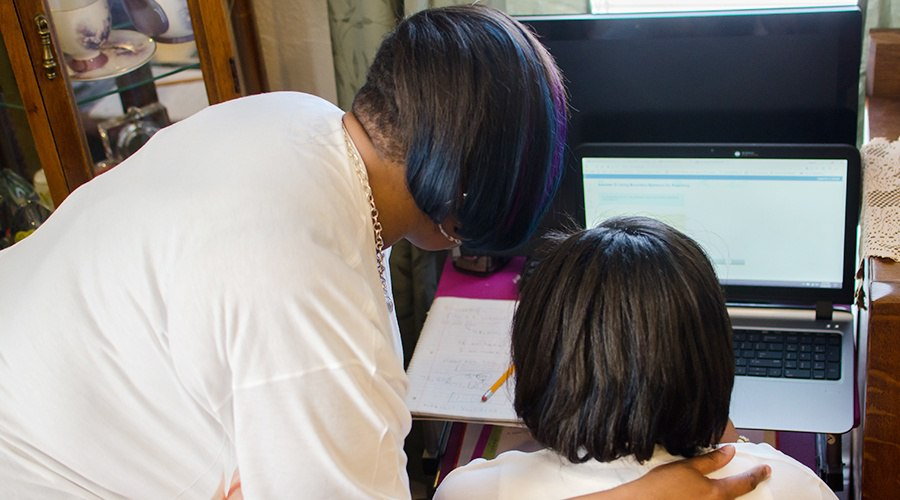 PA Virtual parent looking at laptop screen with her daughter