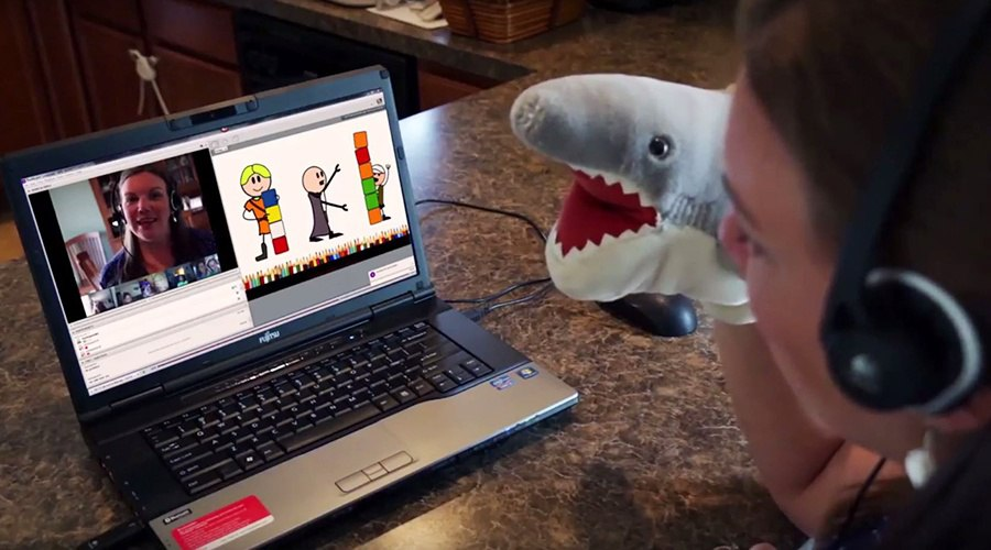 PA Virtual teacher teaching class on webcam with shark puppet