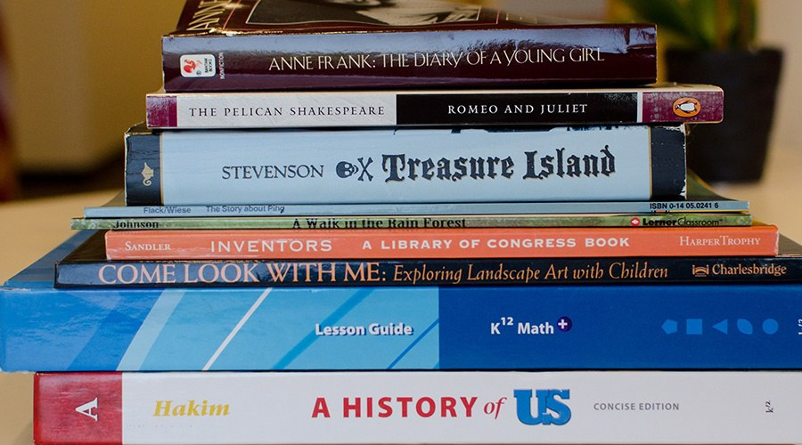 Stack of books and K12, Inc. Curriculum