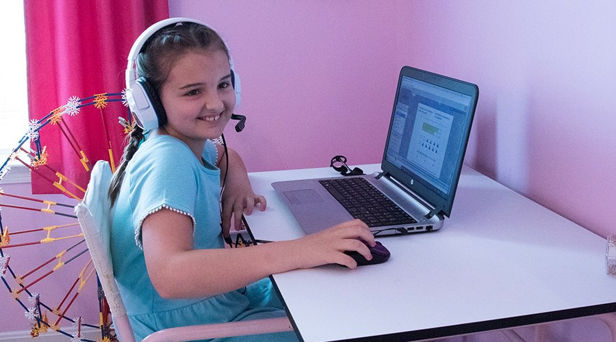 PA Virtual student wears headset and attends class from her laptop