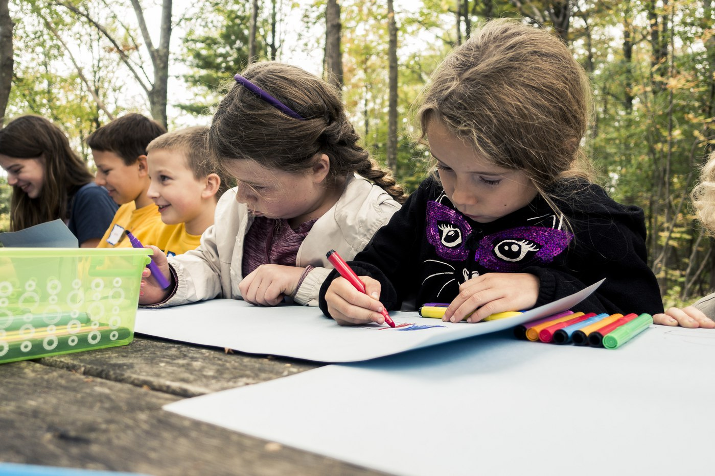 PA cyber school kids drawing together at picnic table