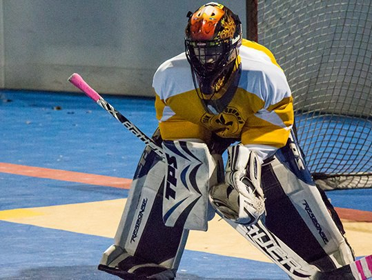 male teen playing hockey